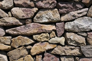 A rock wall is made from a firm foundation