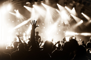 hands raised by the crowd at a live music concert